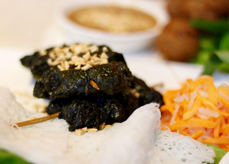 Bò lá lõt (beef wrapped in betal leaves)